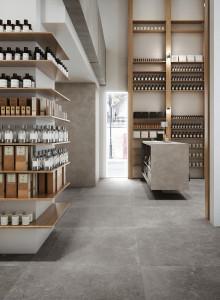 225957_inspirations-carrelage-commerces-pharmacie-grand-espace-pierre-naturelle-de-caractere-imitiation-gres-cerame-gris-schelfhout.jpg