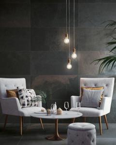 226130-inspiration-carrelage-sejour-salon-tendance-carrelage-acier-oxide-oxyde-metal-entree-lobby-schelfhout.jpg